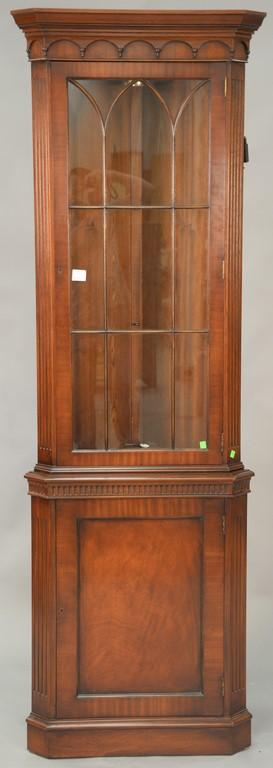 Baker mahogany corner china cabinet with glass shelves. ht. 88in., wd. 27in.