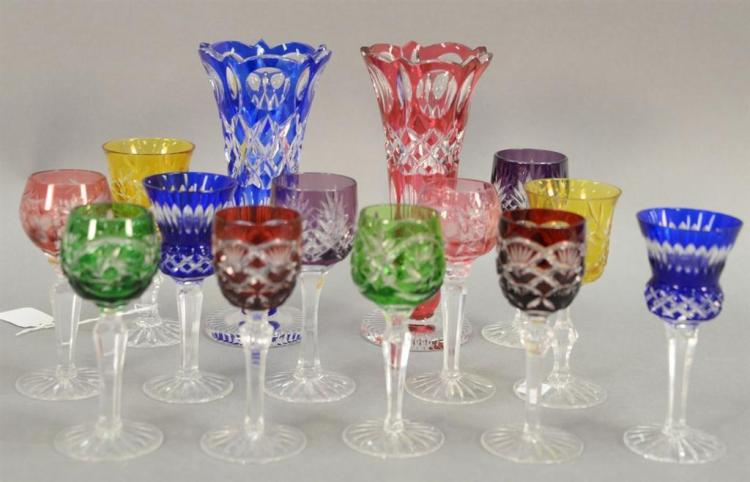 Group of twelve Bohemian cut to clear multicolor stemmed cordials (ht. 5in.) and pair of vases (ht. 7 1/2in.).