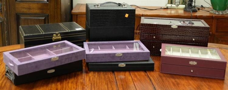 Eight leather fitted jewelry boxes, six are by Prestige. ht. 1 3/4in., lg. 15in. to ht. 12in., lg. 12in.