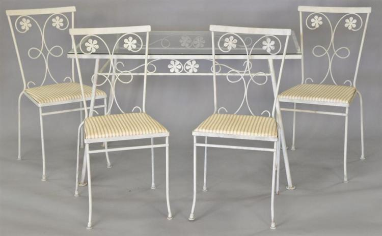 Wrought iron glass top table and four chairs. ht. 29in., top: 28