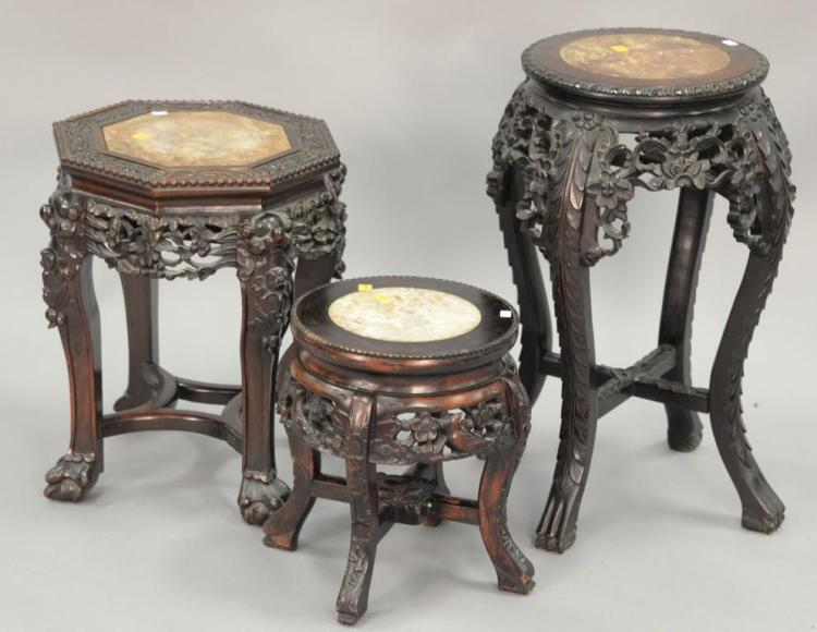 Three Chinese stands with inset marble. ht. 13 1/2in., 18 1/2in., & 24in.