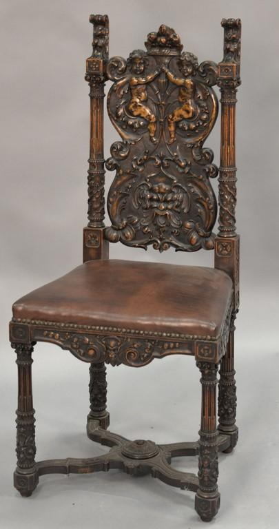 Continental style carved walnut side chair with cherubs.