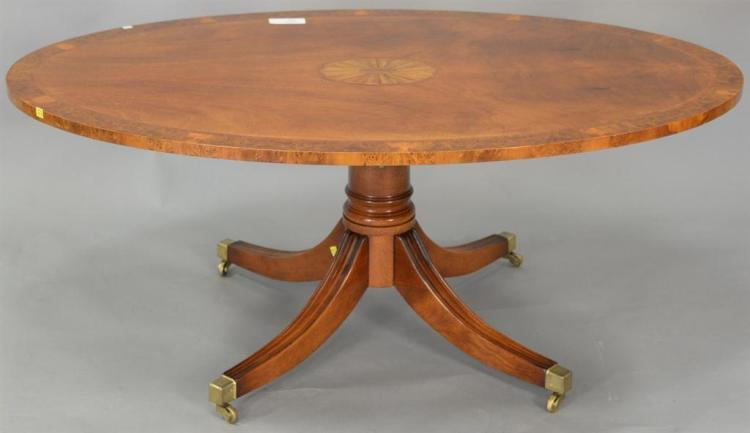 Oval inlaid mahogany coffee table with adjustable height pedestal. ht. 22in., top: 33