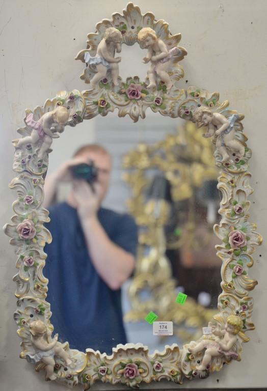 Mirror with French porcelain framed figures and flowers. 29