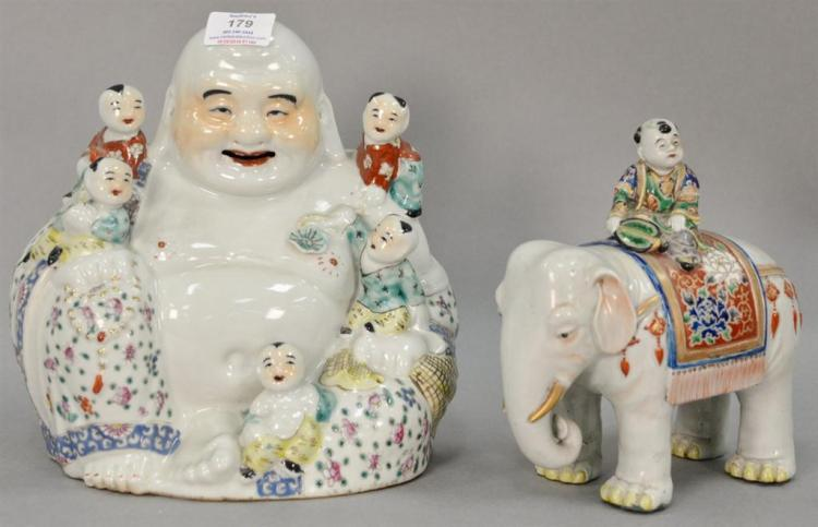 Two Oriental porcelain figural pieces including Budha with boys and an elephant having enameled flower rug and a boy on it. ht. 8 1/...