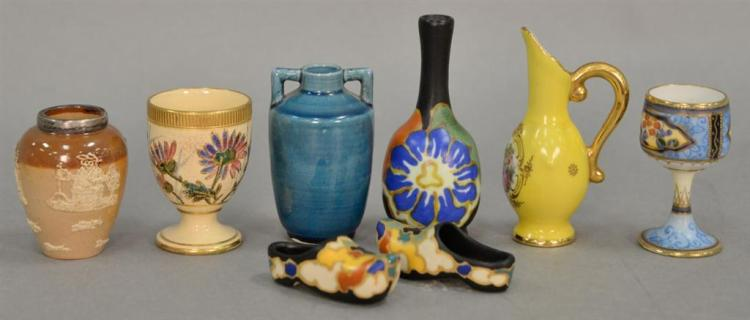 Eight miniature pieces including Doulton Lambeth stoneware vase, blue glazed vase, Royal Goedewaagen vase and shoes, Nippon hand pai...