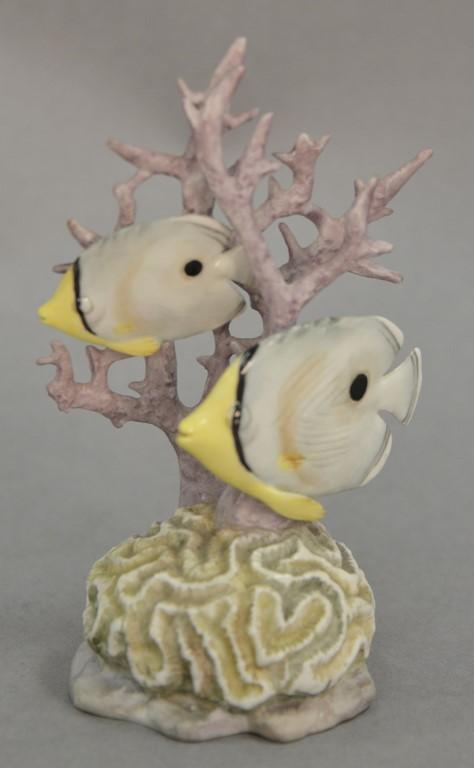Royal Worcester porcelain four eyed fish figurine by Van Ruychevelt, coral with two fish hand painted. ht. 5 1/4in.