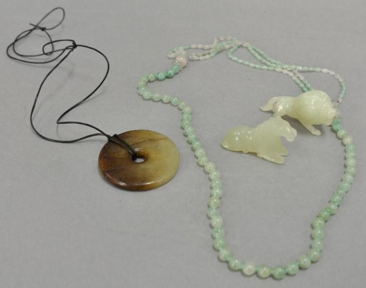 Four Chinese hardstone piecest to include two carved jade? animals, necklace, and a hardstone disc.