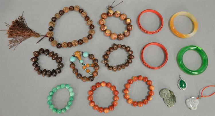Group of fifteen Oriental jewelry to include eight hardwood and resin and hardstone beaded bracelets, jadeight bracelet, two cinnaba...