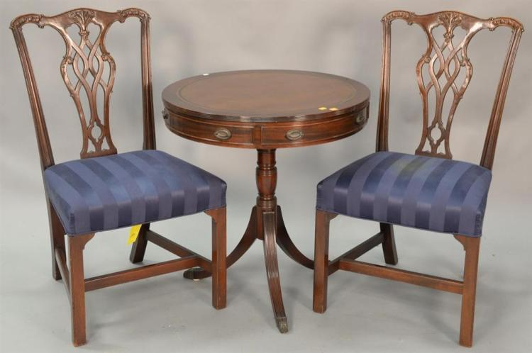 Kittinger three piece lot include two side chairs and a drum table with leather top. dia. 27in.