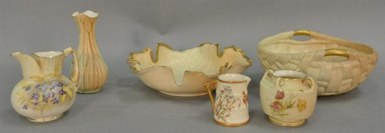 Six pieces of Royal Worcester blush ivory porcelain to include large leaf dish, handled bowl, two vases, and two ewers. ht. 2 1/2in....