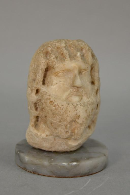 Anhydrite archaic carved bust of a bearded man, ht. 5