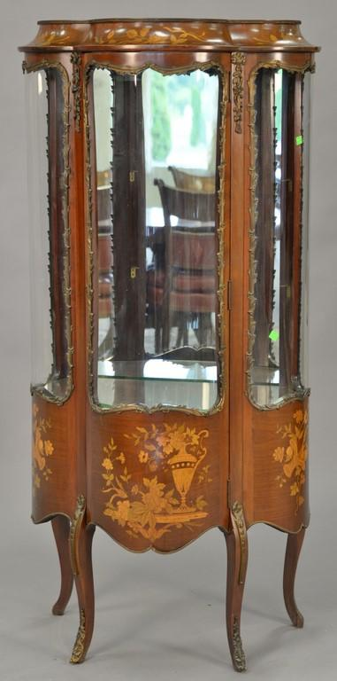 Marquetry inlaid Louis XV style curio cabinet with glass shelves and mirror back. ht. 56 1/2in., wd. 27in.