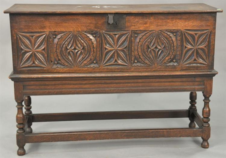 Carved oak dovetailed lift top chest on frame. ht. 31in. wd. 45in. dp. 16in.