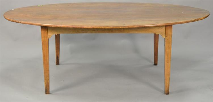 Continental fruitwood oval dining table. ht. 30in., top: 55