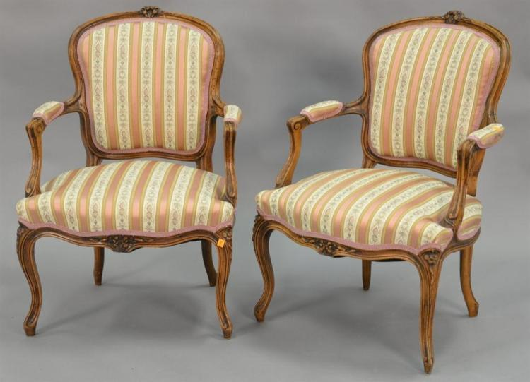 Pair of Louis XV style armchairs with custom silk upholstery in excellent condition.