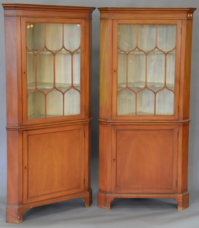 Pair of mahogany corner china cabinets. ht. 72 1/2in., wd. 35in., dp. 20in.