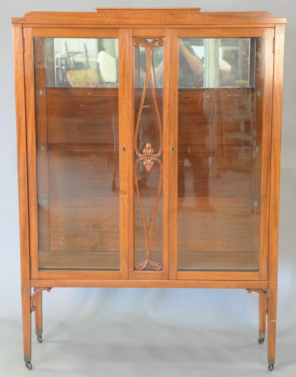Mahogany china cabinet with bellflower inlays. ht. 68in., wd. 48 1/2in., dp. 15 1/2in.