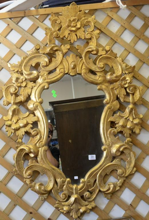 Pair of carved and gilt decorated wood mirrors.ht. 47in., wd. 32in.