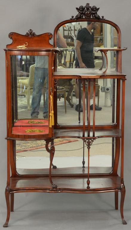 Mahogany Victorian etagere with bowed glass curio cabinet. ht. 68in., wd. 38in., dp. 13in.