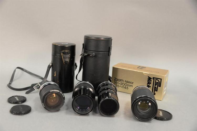 Four lenses to include Nikkor 35 200mm F/3.5 F4.5 lens in original box, Zoom Nikkor 200mm 1:4 with case, Zoom Nikko 35 105mm 1:3.5 4...