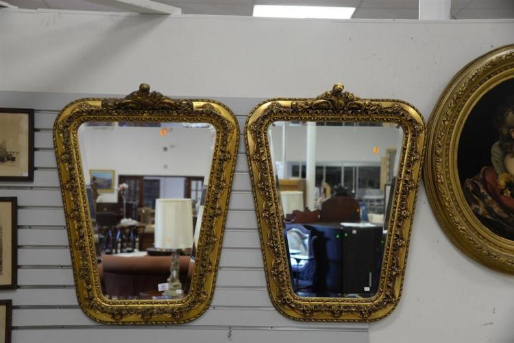 Pair of gold beveled mirrors. ht. 36 1/2