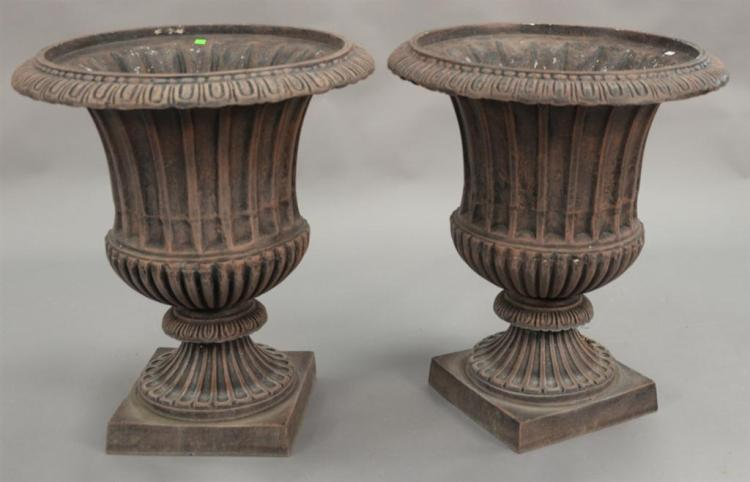 Pair of reproduction iron urns. ht. 29in. dia. 25in.