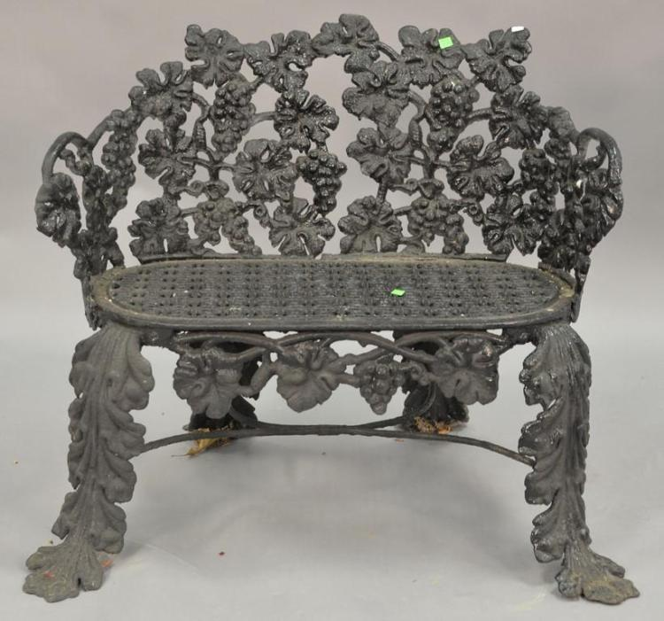 Victorian iron bench with grape motif attributed to Fisk (arm broke at base - as is). wd. 32in.