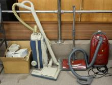 Two vacuumes including Electrolux Epic with filters and bags and a Panasonic EZ Bare Floor.