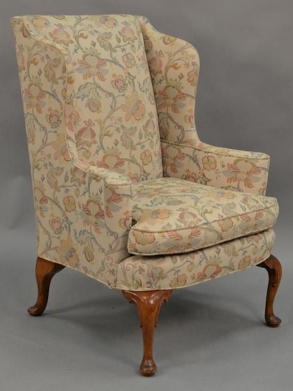 Queen Anne style upholstered wing chair.