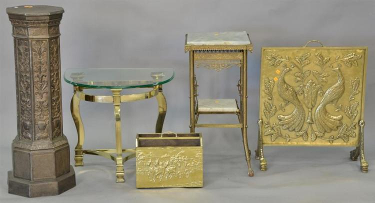 Four piece brass and metal group to include embossed pedestal, embossed brass magazine holder, fire screen, and half round table wit...