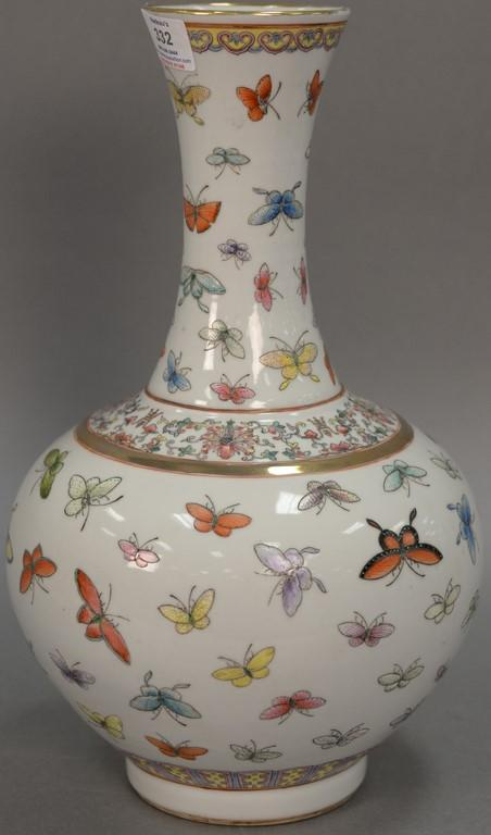 Oriental porcelain butterfly bottle vase having globular body with slender neck and flared rim ornately painted with butterflies. ht...