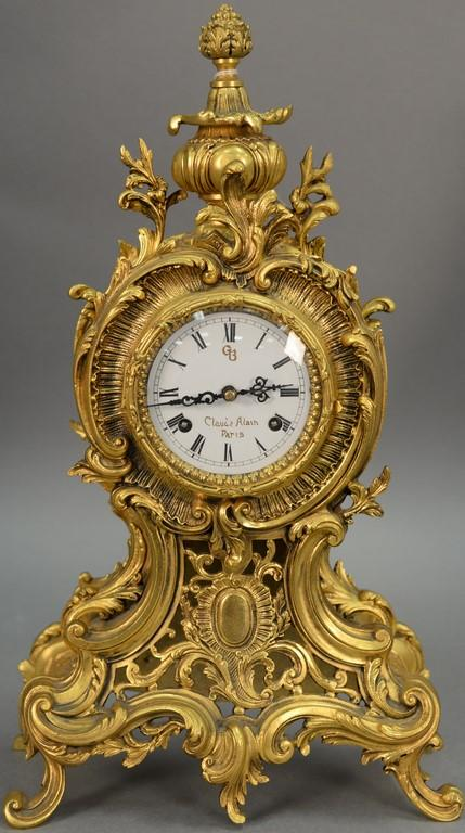 French style brass mantle clock with porcelain dial. ht. 18in.