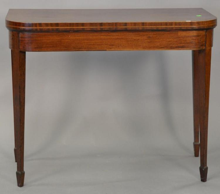 George III mahogany game table with felt interior, circa 1800. ht. 29 1/2in., wd. 37in.