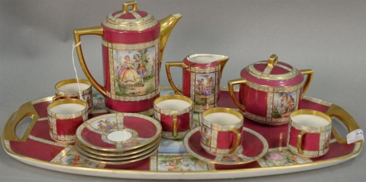 Czechoslovakian porcelain coffee set with tray, coffee pot, creamer, sugar, cups, and saucers. tray: lg. 18 1/2in.
