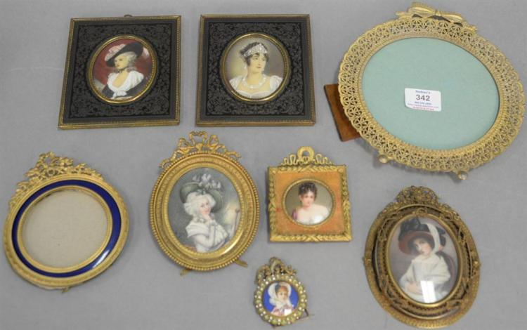 Eight brass and bronze French and Victorian frames, six with painted portraits of women. 2 1/4