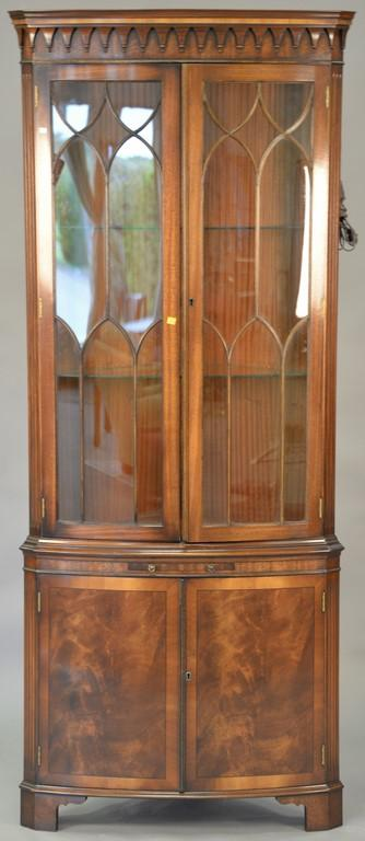 Mahogany corner china cabinet with glass shelves and glazed doors with inside light. ht. 85in., wd. 35in.