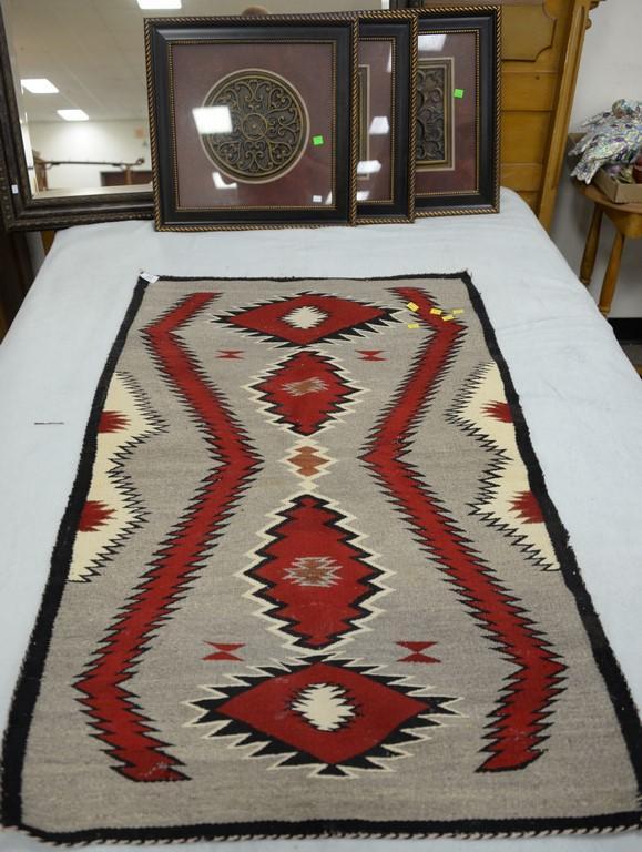 Small Navajo rug. 28