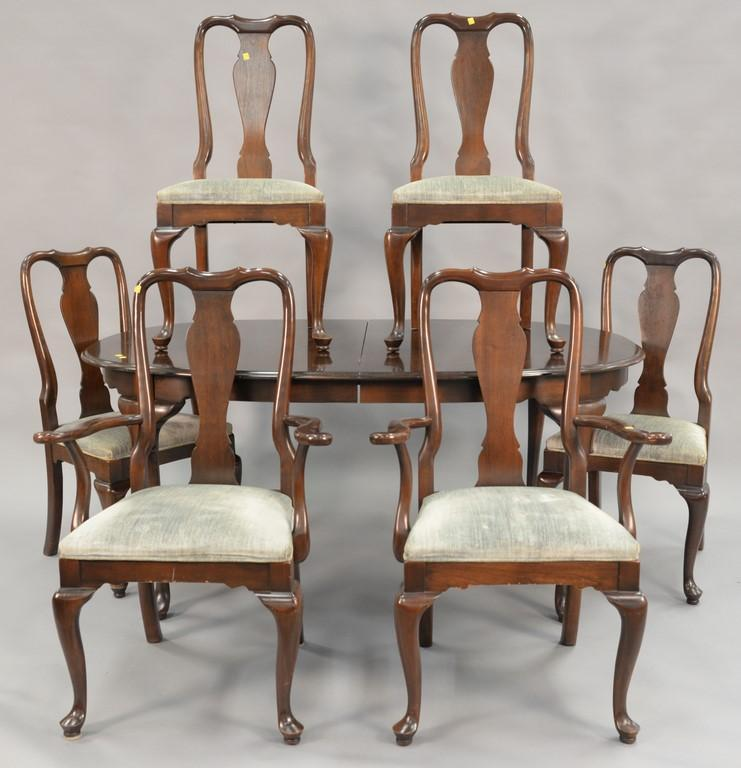 Ethan Allen seven piece dining room set with cherry Queen Anne style table with two leaves and six chairs. ht. 29in.; top: 45