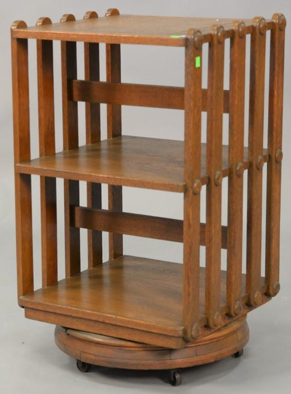Oak revolving bookcase. ht. 31in., top: 17 1/2