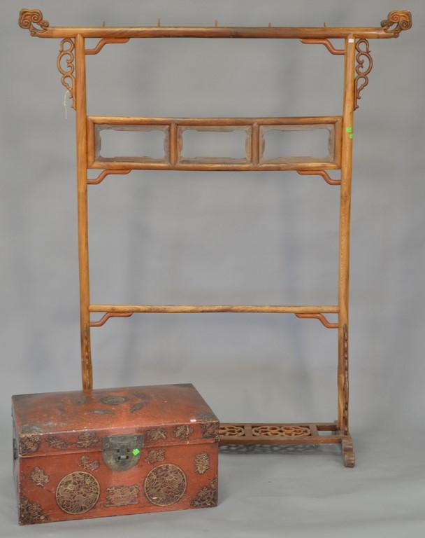 Two piece lot including Chinese rack and Chinese lift top chest. rack: ht. 72in., wd. 61in.; chest: ht. 14in., wd. 28in.