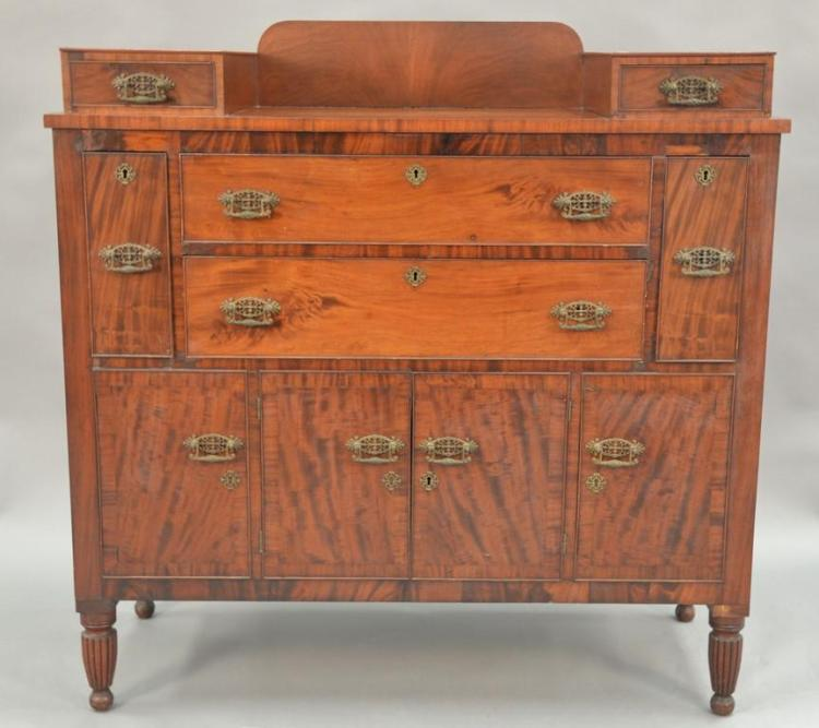 Sheraton mahogany and cherry sideboard, circa 1830. ht. 50in., wd. 47in., dp. 22in.
