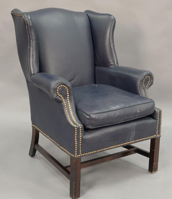 Chippendale style blue leather wing chair.