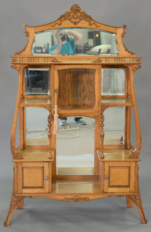 Victorian oak etagere, circa 1870. ht. 70in., wd. 40in., dp. 14in.