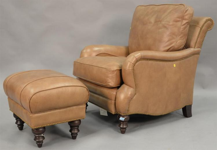Brown leather chair and ottoman.