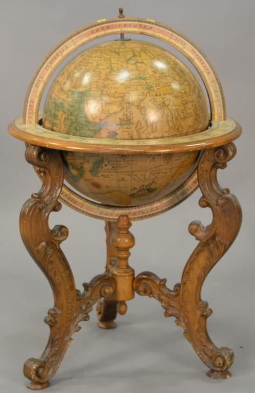 Globe on carved wood base. ht. 34in., dia. 25in.