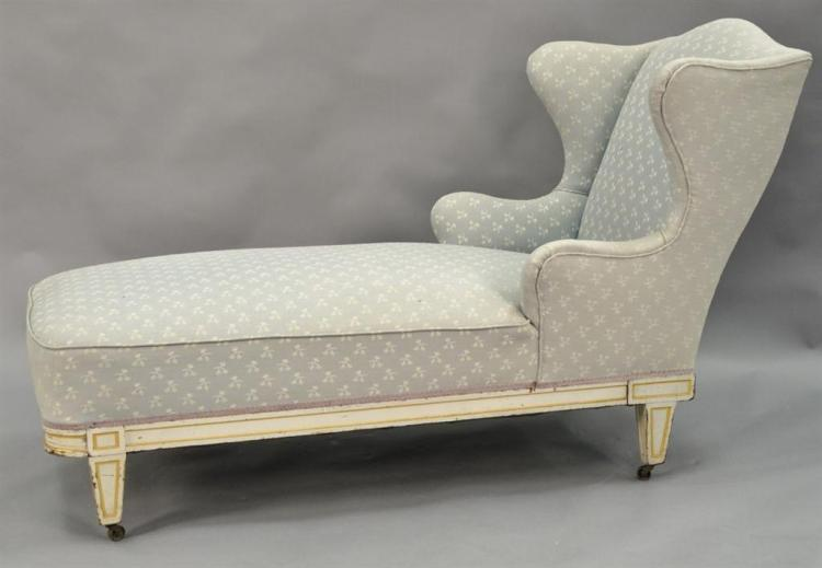 Continental style upholstered chaise in need of new upholstery.