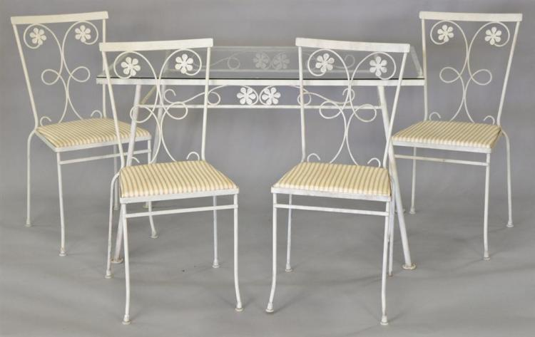 Wrought iron glass top table and four chairs. ht. 29in., top: 25