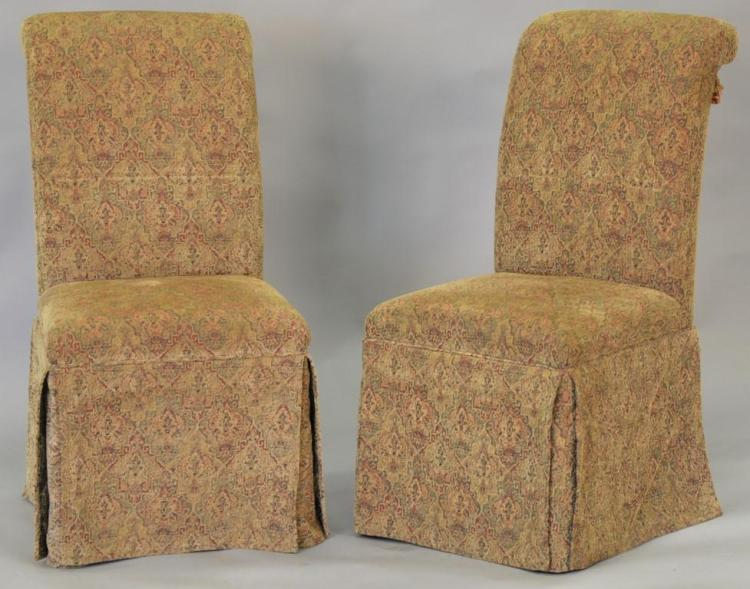 Six upholstered dining chairs.