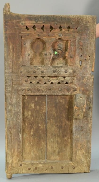 Primitive carved door and large steel head nail decoration, possibly several hundred years old, 29